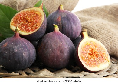 Ripe sweet figs with leaves, close up
