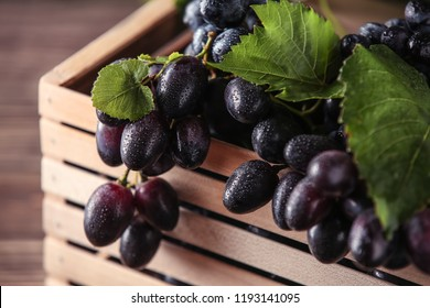 Ripe sweet grapes in wooden box