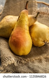 Ripe and sweet pears on wooden table.  Fruit background. Fresh organic pears on old wood. Pear autumn harvest
