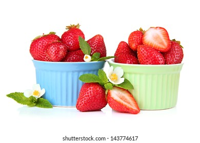 Ripe sweet strawberries in bowls, isolated on white