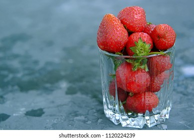 Ripe sweet strawberries in a glass. Healhty eating and summer concept.