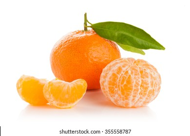 Ripe sweet tangerine with leaves, isolated on white
