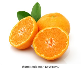 Ripe tangerines with leaves and slices isolated on white background