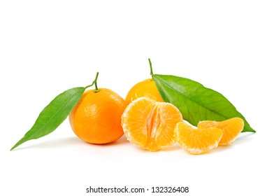 Ripe  tangerines (mandarin) with half and green leaf isolated on white
