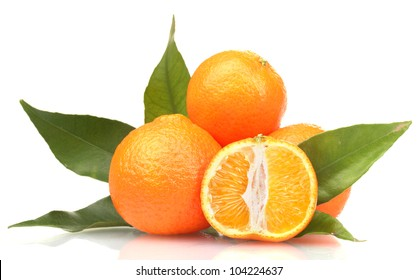 Ripe tasty tangerines with leaves and segments isolated on white