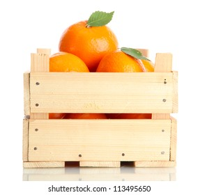 Ripe tasty tangerines with leaves in wooden box isolated on white