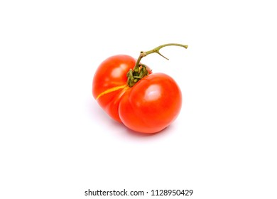 The ripe tomato is a siamese twins isolated on white background