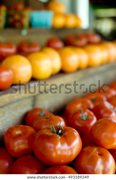 Ripe tomatoes at local Farmer's Market. Shallow DOF.