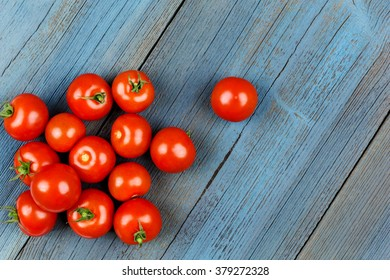 Ripe tomatoes on a blue board