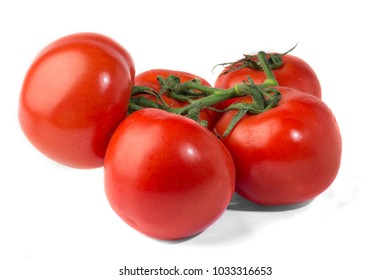 Ripe tomatoes on a branch. Isolated.