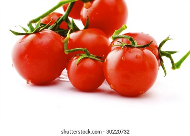 Ripe tomatoes on a branch on a white background