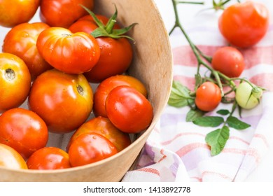 Ripe tomatoes in the sieve, tomatoes are prepared for preparing preserves, cooking and food concept