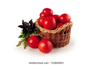 ripe tomatoes in a wicker basket on a white background
