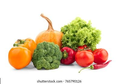 Ripe vegetables on white background