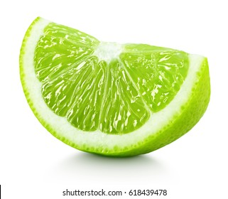Ripe wedge of green lime citrus fruit isolated on white background. Lime slice with clipping path
