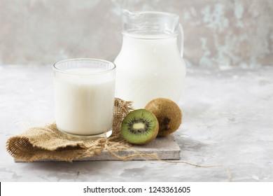 Ripe whole kiwi fruit with milk or kefir