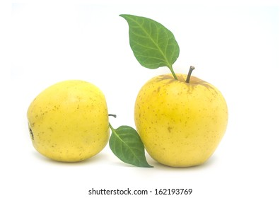 ripe yellow apple on a white background