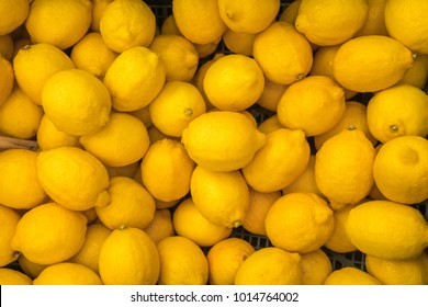 Ripe yellow lemons, background, texture