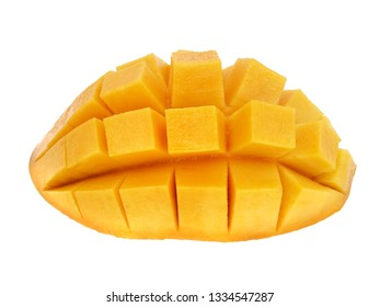 Ripe yellow Mangoes cut half in cubes isolated on white background.