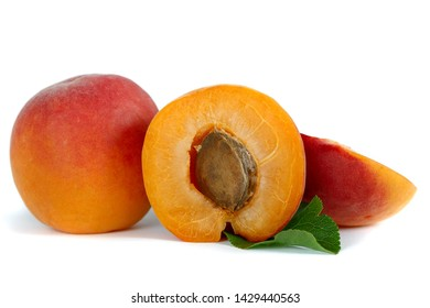 Ripe yellow-red apricots, half with bone and whole in cut close-up