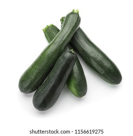 Ripe zucchinis on white background