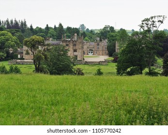 Ripley Castle surrounded by trees and green fields, North Yorkshire, England