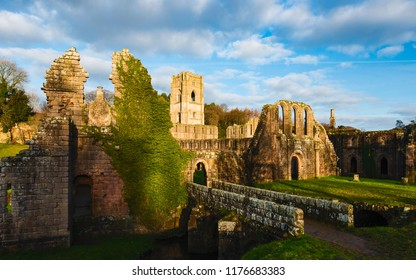 RIPON, UK - DECEMBER 03, 2017:. The ruins of Fountains Abbey on a fine autumn morning as viewed from across the river Skell on December 03, 2017 near Ripon, Yorkshire, UK.