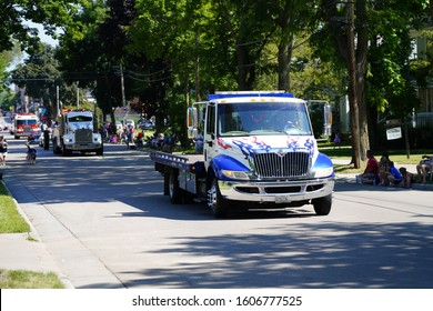 Ripon, Wisconsin / USA - July 13th, 2019:  Extreme Towing Drove their flatbed and Integrated Tow Trucks through Ripon Fest 2.0 Festival Parade to help promote themselves.