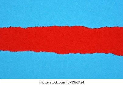 Ripped in blue paper on red background