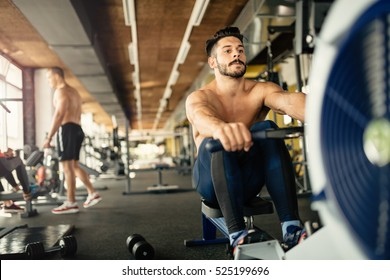 Ripped bodybuilder working out in gym
