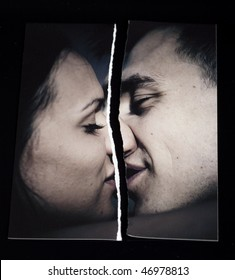 Ripped photograph concept.  Broken love relationship