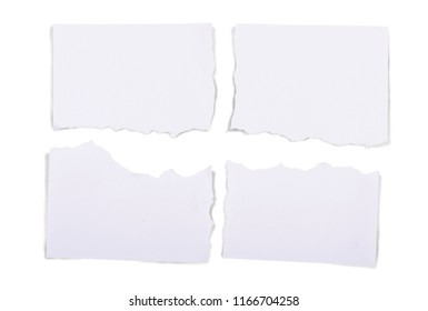 Ripped pieces of white paper isolated over white background