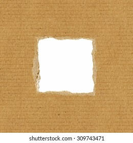 Ripped square hole in cardboard on white background. Design isolated element.