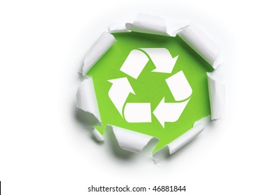 ripped white paper with recycle logo against a green background