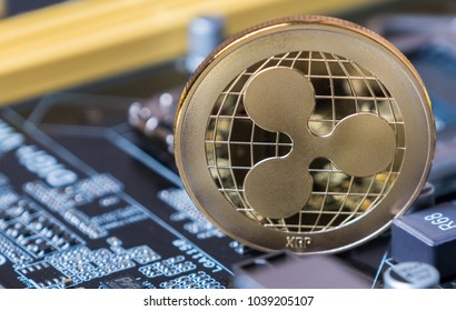 Ripple coin crypto currency on computer motherboard.
