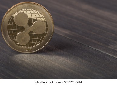 Ripple coin cryptocurrency on wooden background