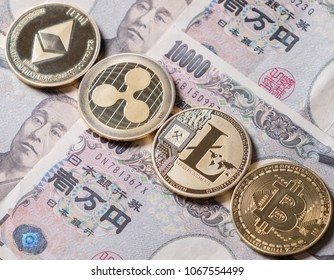 Ripple coin, ethereum, litecoin and bitcoin cryptocurrency on Japanese yen currency