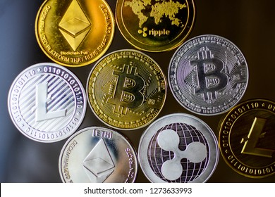 Ripple coin, ethereum, litecoin and bitcoin cryptocurrency on glass table - Image