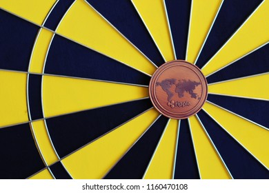 Ripple coin in the middle of dartboard. Ripple investment as a goal.