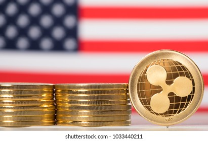 Ripple coins cryptocurrency against USA flag