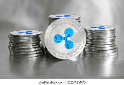 Ripple cryptocurrency (XRP) closeup. Stack of silver coins. Cyber money.