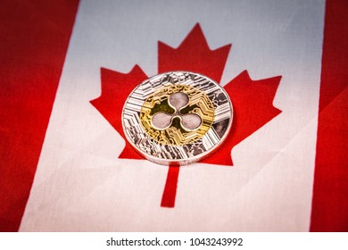 Ripple (xrp) and Canada Flag. Concept for investors in crypt ocurrency and Blockchain Technology in Canada.