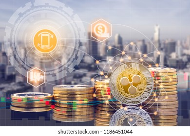 Ripple XRP and cryptocurrency investing concept - Physical Ripple coins with city background and exchange market trading price chart. Blockchain and financial technology.