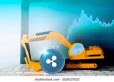 Ripple (XRP) mining concept; miniature Excavator and Ripple (XRP) coin on the computer (laptop) keyboard on the background of the financial schedule