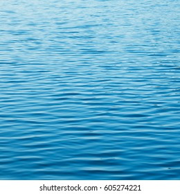 A rippled body of water with a  deep blue color