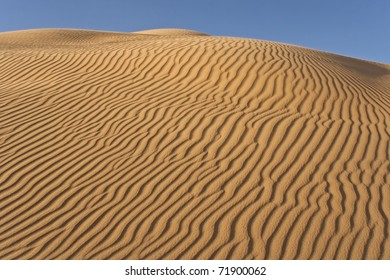 Rippled sand dune on late afternoon (Imperial Dunes, California)