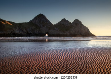 Rippled sand landscape at Three Cliffs Bay on the Gower peninsula, Swansea, UK