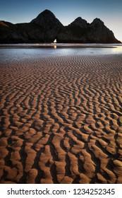Rippled sand landscape at Three Cliffs Bay, Gower, Swansea, UK