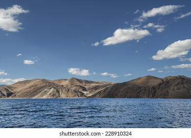 Rippled surface of blue mountain lake among desert hills