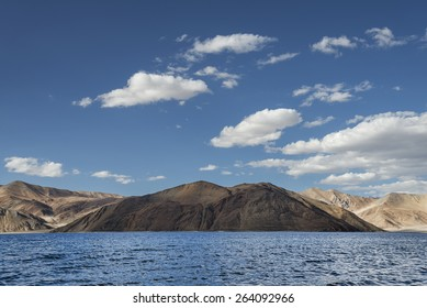 Rippled surface of high altitude mountain lake among sand and rock hills